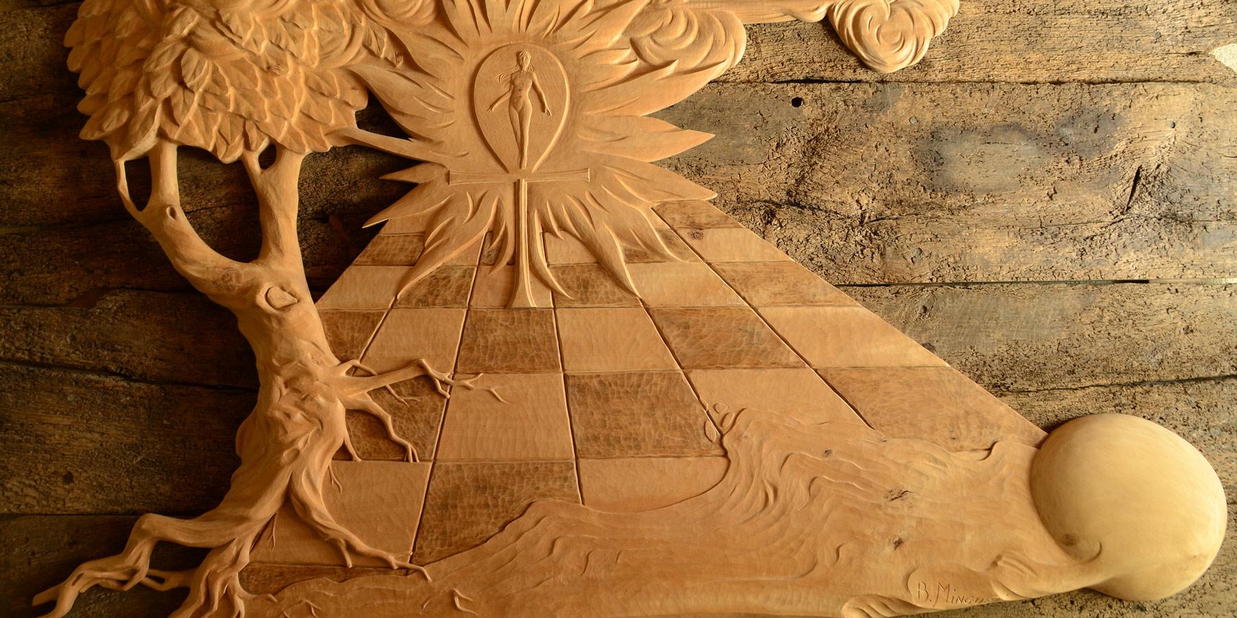 Sculpture murale en bois, naissance